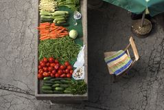 Market stall with red and green vegetables. Fresh, organic vegetables on market stall.  Colorful vegetables against old grey concrete stall and cracked decaying Stock Photos