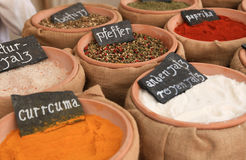 Market stall with sacks filled with spices Stock Image