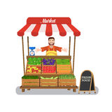 Market stall with salesman trading vegetables. Stock Photos