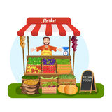 Market stall with salesman trading vegetables. Stock Photo