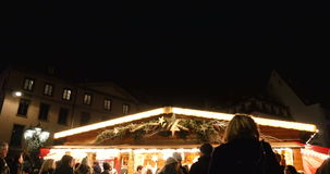 Market stall sellign mulled wine and Christmas sweets stock video footage