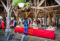 Market stall under medieval market hall with massive limestone roof taken in Nolay, Burgundy, France stock photos