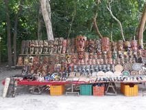 Market stalls at Chichen Itza mexico. Market stalls at Chichen Itza archeological site in Mexico where people are selling wooden Mayan masks, souvenirs and Stock Photos