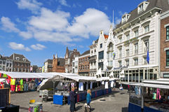 Market stalls and historic buildings, Den Bosch. Netherlands, province North Brabant, provincial capital, city 's-Hertogenbosch or Den Bosch in the conservation Royalty Free Stock Images