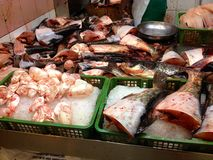 Market stalls in Singapore China Town. Various types of market stalls in the Wet Market in China Town Singapore, Selling Fishes, Vegetables, fruits, slippers and royalty free stock image