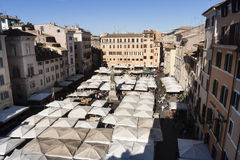 Market stalls tends, Piazza Campo de Fiori. Rome, Italy. Market Piazza Campo de Fiori in Rome in Italy. Aerial view. The famous market in the historic center of stock photography