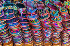 Market stand with colorful sandals. In India Royalty Free Stock Images