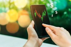 Market stock graph icon screen of smartphone background. Financial business technology freedom dream life using internet freedom. Life concept stock photo