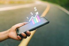 Market stock graph icon screen of smartphone background. Financial business technology freedom dream life using internet freedom l. Ife concept royalty free stock image