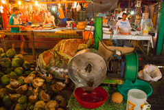 Market on the street. Selling coconuts. Manila, Philippines. Royalty Free Stock Photo