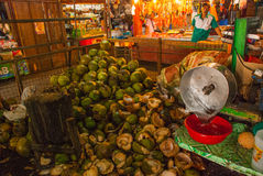 Market on the street. Selling coconuts. Manila, Philippines. Royalty Free Stock Image