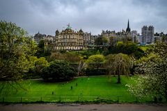 Market Street view from Prince Street Gardens, with People walking along the gardens during a rainy day in spring. People walking along Prince Street Gardens royalty free stock photography