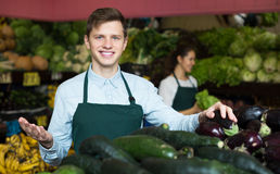 Market stuff offering slicing cucumbers Stock Images