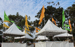 Market tents at rural carnival. White market tents set up ready for sellers at rural festival Stock Photography