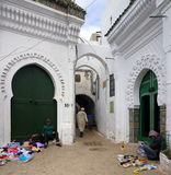 Market in Tetouan, Morocco. People are selling items of clothing and shoes in this section of the old part of town (Kasbah) of Tetouan, Morocco Royalty Free Stock Image