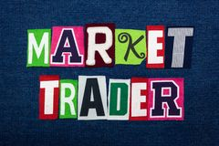 MARKET TRADER text word collage, multi colored fabric on blue denim, stock and investing concept. Horizontal aspect stock images