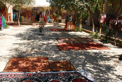 The market in Uzbekistan, carpets in the shade. Trade area in Bukhara in the shade royalty free stock photo