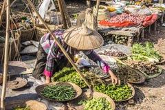 Market vendor. A market vendor at a market at the bank of the famous lake Inle, Myanmar Stock Image