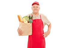 Market vendor holding a bag full of groceries Royalty Free Stock Photography