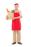 Market vendor holding a bag full of groceries Royalty Free Stock Image