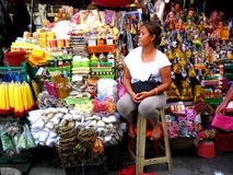 Market vendor selling  religious items beside quiapo church in the philippines Royalty Free Stock Photo