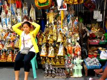 Market vendor selling  religious items beside quiapo church in the philippines Stock Images
