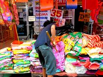 Market vendor selling  textile and fabric products quiapo in the philippines Royalty Free Stock Images