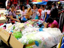 Market vendor selling textile and fabric products quiapo in the philippines Stock Photo