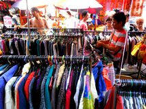 Market vendor selling textile and fabric products quiapo in the philippines Royalty Free Stock Image