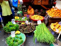 Market vendor selling vegetables in a market in philippines Stock Photography