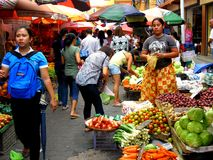 Market vendor selling vegetables in a market in philippines Royalty Free Stock Photography