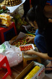Market vendor takes  quick lunch Royalty Free Stock Photography