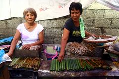 Market vendors sell local delicacy snack known as  Royalty Free Stock Images