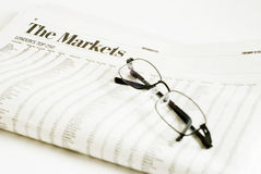 Market Watch. Glasses on a financial newspaper titled - The Markets Stock Images