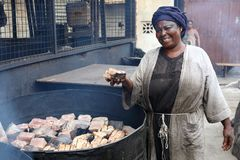 A market woman in Accra, Ghana. A market woman sells smoked fish in the fishing village Jamestown in Accra, Ghana Stock Image