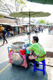 Market woman selling Ice cream. stock photography