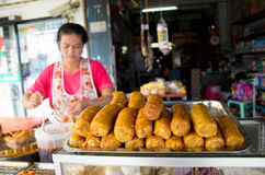 Market woman selling sausages. royalty free stock images