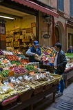 Market worker. Man stocks fruits and vegetables in a characteristic street market of Bologna, Italy Royalty Free Stock Photo
