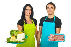 Market workers offering products Royalty Free Stock Photography