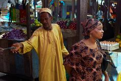 A Market in ZAnzibar: A Man reaches for a knife. royalty free stock photo