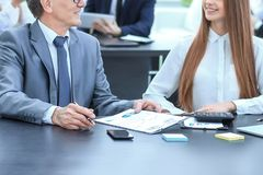 Marketer and team Manager working with paper charts. stock image