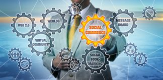 Marketer Touching Social Commerce Cogwheel. Torso of marketer touching Social Commerce cogwheel in virtual gear train. Business and technology metaphor for web 2 royalty free stock image