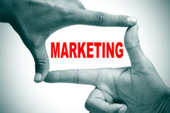 Marketing. Man hands making a frame with its fingers and the word marketing written inside Royalty Free Stock Images