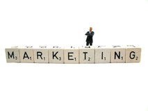 Marketing. A sales manager standing behind the word marketing stock images
