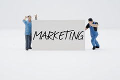 Marketing. Two men holding a sign Stock Image