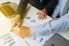Marketing analysis team meeting concept. Young businessman crew. Working with new startup project in modern studio and notebook on wood table royalty free stock photography