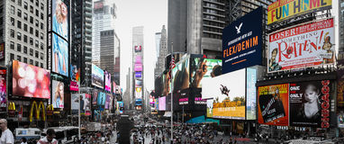 Marketing Bombardment. A typical day in Times Square, New York City where residents and tourists are bombarded by different colorful advertisements Royalty Free Stock Images