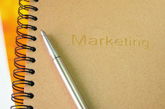 Marketing book with Silver pen Stock Photography