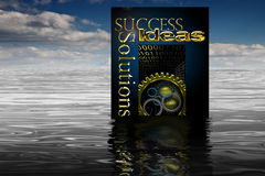 Marketing Book of Success. Book on success floating on water with refection Stock Photos