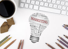 MARKETING bulb word cloud. White office desk.  Stock Images